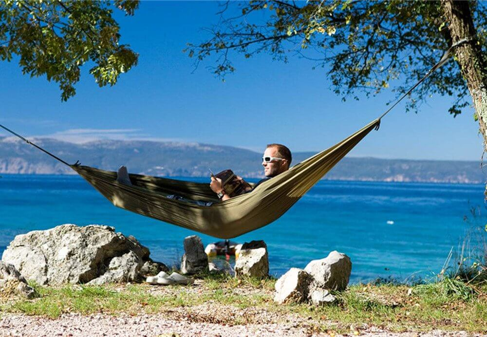 Motorhome life in a hammock, one of the top glamping gadgets