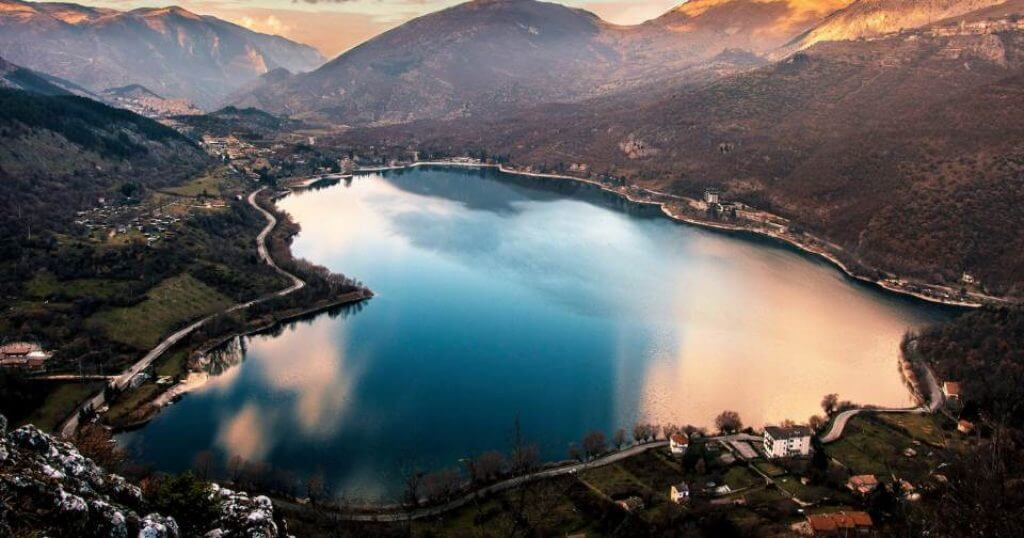 Heart shaped lake surrounded by mountains at dusk
