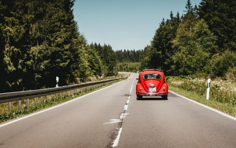 Red classic car on UK road