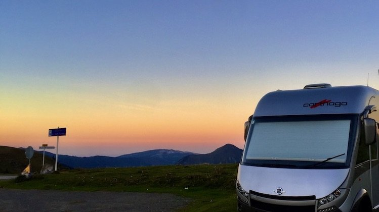 motorhome wild camping in France mountains with orange sunset