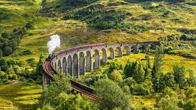 Glenfinnan arched viaduct with a steam train