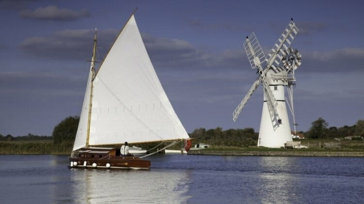 Wherry sailing barge and windmill in the Norfolk Broads