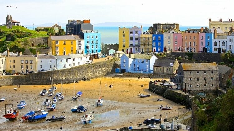 Tenby with colourful houses, beach and small fishing boats