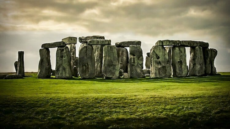 Stonhenge in green fields with cloudy skies