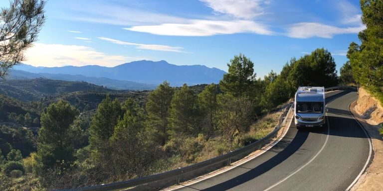 Motorhome on a road in Spain with blue skies and mountains