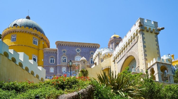 Yello ane mauve buildings of Pena Palace in Sintra