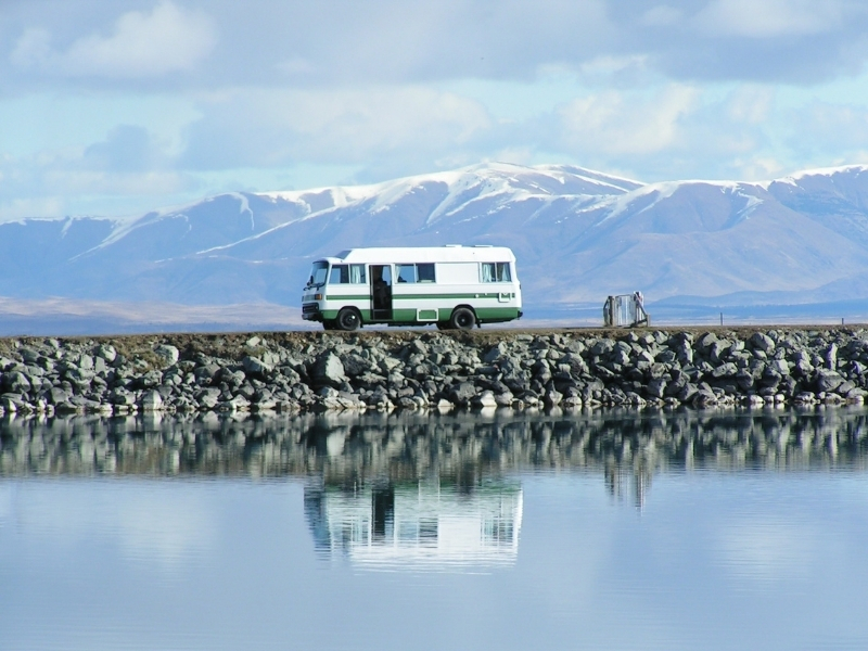 motorhome wild camping by water with mountains